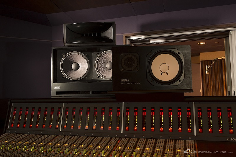 Yamaha NS10M Studio Speakers mounted sideways in studio with mixing console