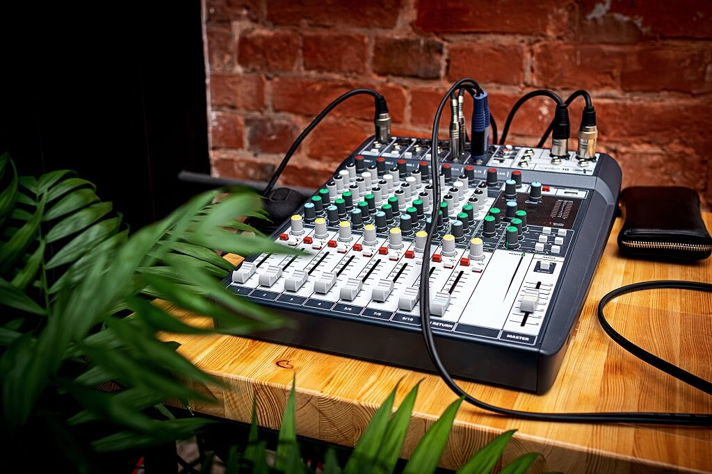 Mixing console with cables plugged in for recording
