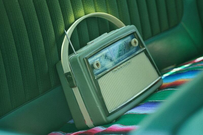 Vintage Radio on the seat of a vintage car