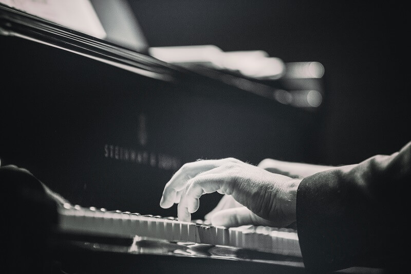 Steinway Grand Piano with hands playing
