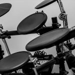 Roland Electronic Drum Kit with black pads and cymbal trigger pads