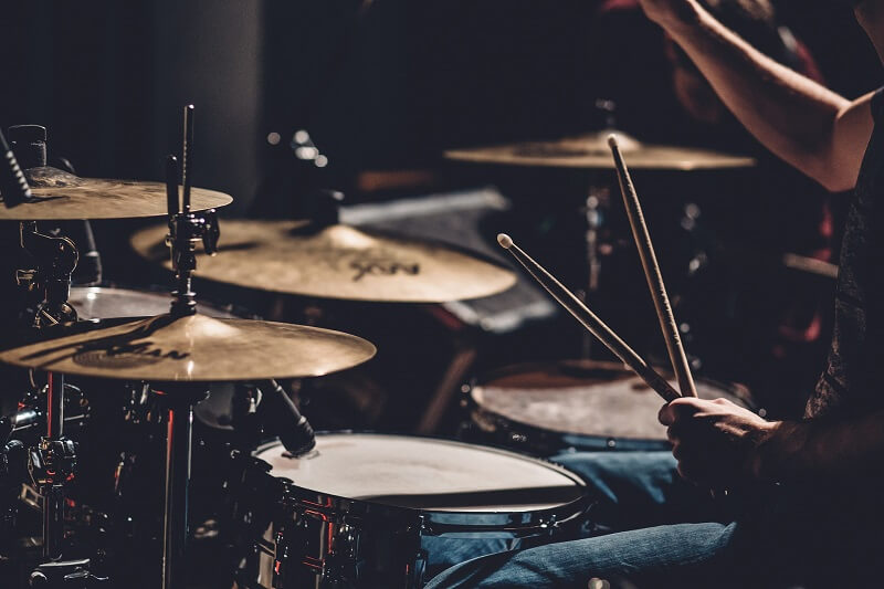 Drum kit with cymbals and sticks and mics for recording